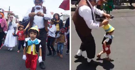 這對父子扮演「皮諾丘&老木匠」馬上成為焦點,老爸「牽線」小男孩「像木偶一樣揮手」萌到融化了!(影片)